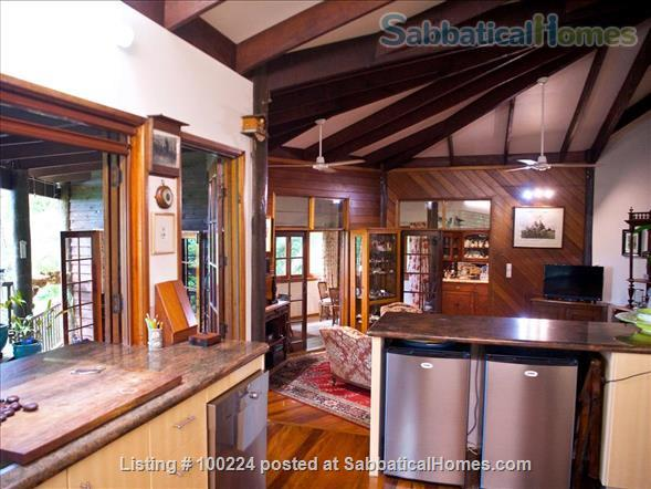 a rainforest pole home, backing onto the cassowary hills with views of the coral sea Home Rental in Killaloe, QLD, Australia 6