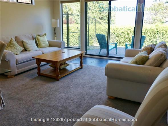 Bright, modern 2-bedroom suite: Ocean Views, walk  to Arbutus Cove & UVic. Home Rental in Victoria, British Columbia, Canada 1