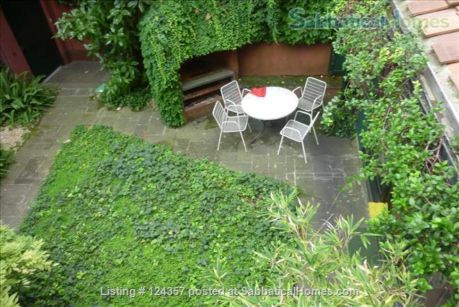 listing image for A haven of green and light in the centre of Rome: totally silent independent house with a large roof top terrace and a lush private garden.