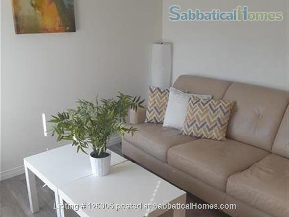 BEAUTIFUL 4-Story Townhouse 4BR + EXTRA ROOM, 2.5 BATH  Nature & Downtown Home Rental in Guelph, Ontario, Canada 1