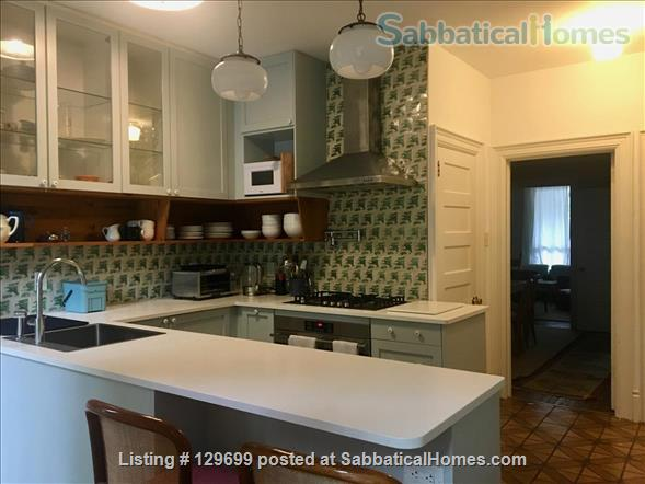 Lovely downtown house: 3 bedroom + 2 studies, back yard, front porch, electric car parking Home Rental in Toronto, Ontario, Canada 1