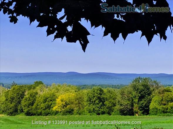 Amherst Center Massachusetts Rental Coveted Location (some flexibility on dates): Furnished 3 BR Home with  RARE Long-range Mountain Sunset View. $2,350/month.  Home Rental in Amherst, Massachusetts, United States 1