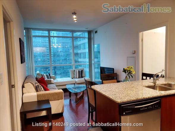 Downtown Furnished 2 Bed + Den 2 Bath Condo, next to Union Subway & Financial Area Home Rental in Toronto, Ontario, Canada 1
