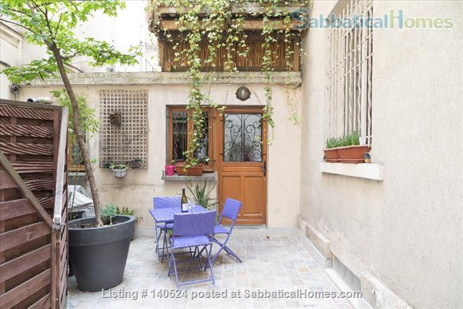 3-storey house, 3 bdr, 3 bath with private courtyard in Central Paris Home Rental in Paris, IDF, France 1