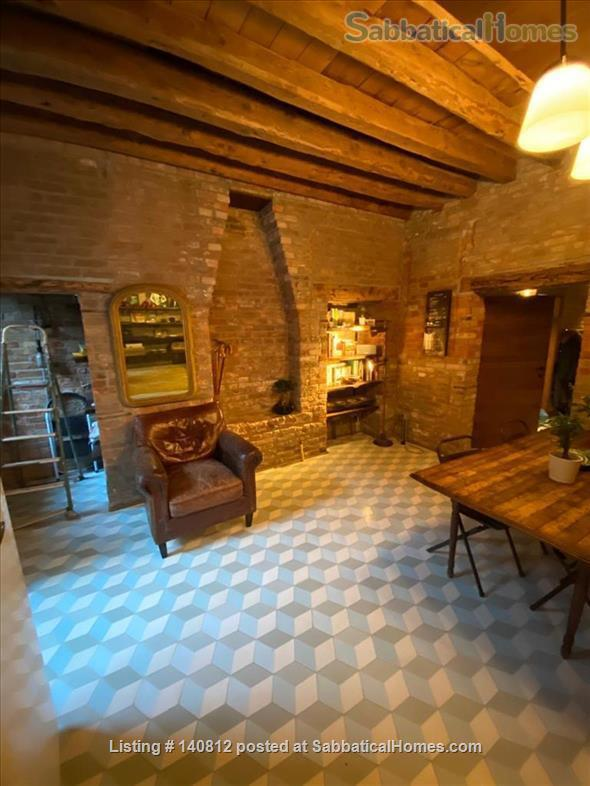One-of-a-kind, 3-bedroom, 2-bathroom landmark apartment in the heart of cool Dorsoduro, stylishly renovated back to its original brick, salvaged wood and stone. It has its own private entrance and quiet, private backyard. A rare find in Venice. Codic Home Rental in Venice, Veneto, Italy 1