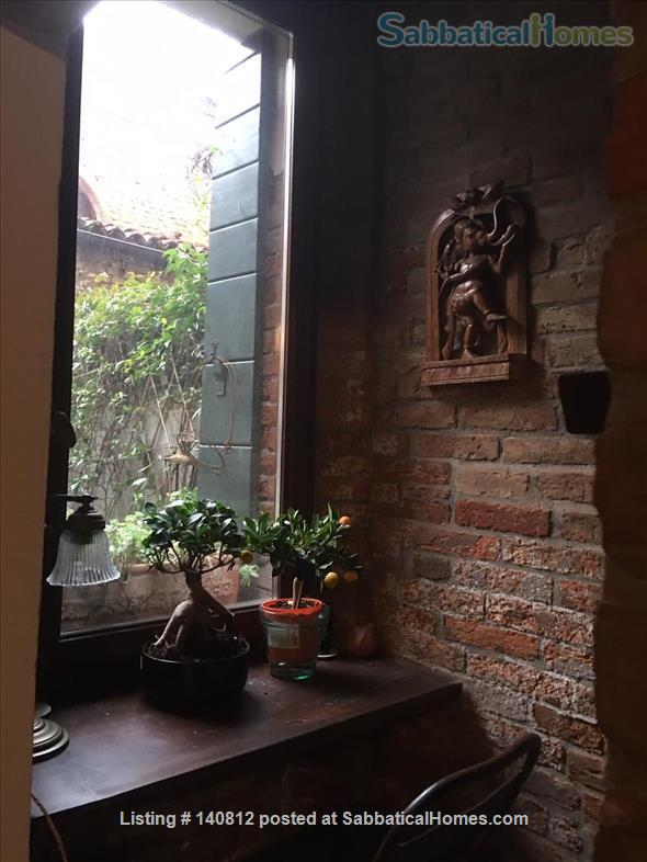 One-of-a-kind, 3-bedroom, 2-bathroom landmark apartment in the heart of cool Dorsoduro, stylishly renovated back to its original brick, salvaged wood and stone. It has its own private entrance and quiet, private backyard. A rare find in Venice. Codic Home Rental in Venice, Veneto, Italy 0