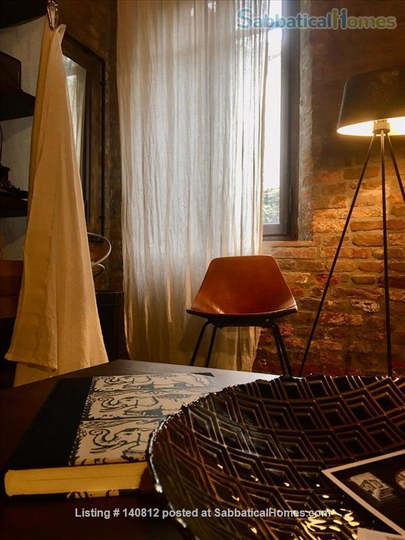 One-of-a-kind, 3-bedroom, 2-bathroom landmark apartment in the heart of cool Dorsoduro, stylishly renovated back to its original brick, salvaged wood and stone. It has its own private entrance and quiet, private backyard. A rare find in Venice. Codic Home Rental in Venice, Veneto, Italy 2