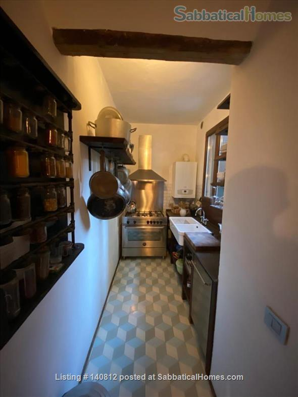 One-of-a-kind, 3-bedroom, 2-bathroom landmark apartment in the heart of cool Dorsoduro, stylishly renovated back to its original brick, salvaged wood and stone. It has its own private entrance and quiet, private backyard. A rare find in Venice. Codic Home Rental in Venice, Veneto, Italy 3