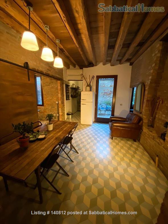 One-of-a-kind, 3-bedroom, 2-bathroom landmark apartment in the heart of cool Dorsoduro, stylishly renovated back to its original brick, salvaged wood and stone. It has its own private entrance and quiet, private backyard. A rare find in Venice. Codic Home Rental in Venice, Veneto, Italy 4
