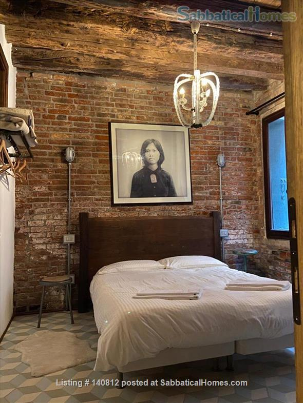 One-of-a-kind, 3-bedroom, 2-bathroom landmark apartment in the heart of cool Dorsoduro, stylishly renovated back to its original brick, salvaged wood and stone. It has its own private entrance and quiet, private backyard. A rare find in Venice. Codic Home Rental in Venice, Veneto, Italy 6