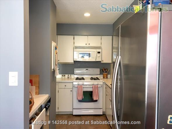Contemporary two stories Condo (2BR + 2 BATH), fully furnished in the Fresh Pond Area. 1 mile from Harvard Sq. Utilities included with backyard, BBQ and indoors heated pool. Home Rental in Cambridge, Massachusetts, United States 0