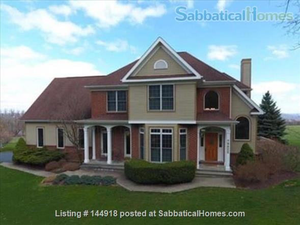 Beautiful FURNISHED large home (5 BDR, 4 BATH)  with in-home gym, playground, expansive views, spacious grounds, Close to both Cayuga Med and Cornell University Home Rental in Ithaca, New York, United States 1