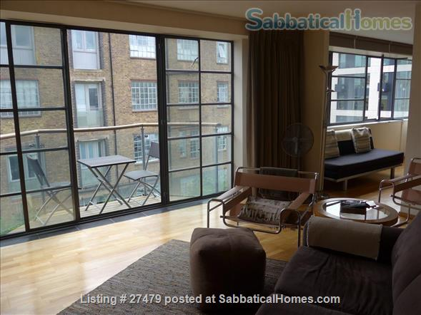 Light-filled flat in central London with canal view, superb transport connections, 24-hour security, all utilities. Walk to Eurostar and British Library. Home Rental in London, England, United Kingdom 1