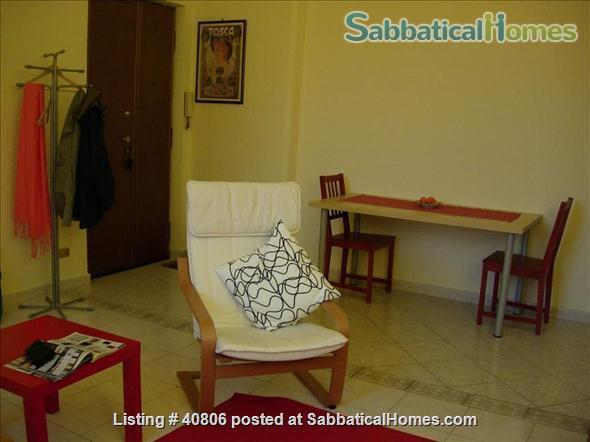 Spacious and bright 2-bedroom apartment on quiet one-way street near lively commercial district; quick access to city center; near Appia Antica Park Home Rental in Rome, Lazio, Italy 0