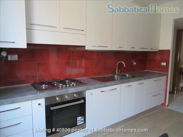 Spacious and bright 2-bedroom apartment on quiet one-way street near lively commercial district; quick access to city center; near Appia Antica Park Home Rental in Rome, Lazio, Italy 2