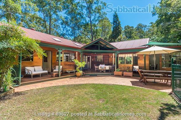 Family home in a bush setting close to The University of Queensland & schools. 3 bedroom, library, music room, study + Pool, privacy, space. Home Rental in Brisbane, QLD, Australia 1