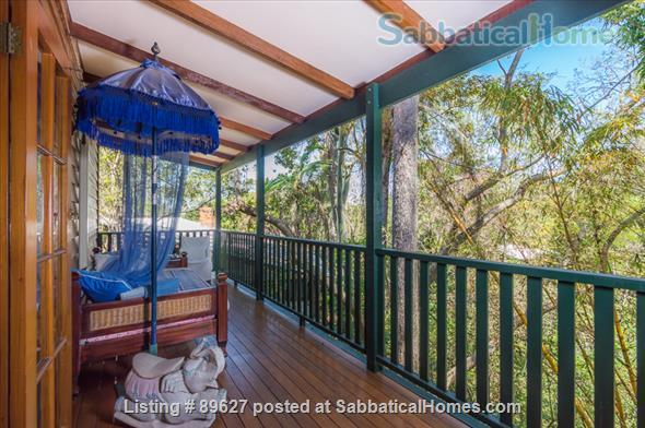 Family home in a bush setting close to The University of Queensland & schools. 3 bedroom, library, music room, study + Pool, privacy, space. Home Rental in Brisbane, QLD, Australia 4